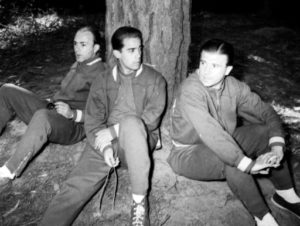 Veteran soccer star, Hungarian-born Ferenc Puskas, right, talks with an unidentified team-mate as they relax under a tree with another Spanish veteran Alfredo Di Stefano at the Spanish team's Football World Cup training camp near Vina Del Mar, Chile, on May 29, 1962. (AP Photo)
